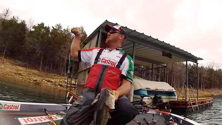 iON  David Dudley tangles with giant bass under dock