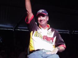 Larry Nixon of Bee Branch, Ark., waves to the crowd during the final weigh-in of the 2000 FLW Championship in Shreveport, La. Nixon finished in fourth place.