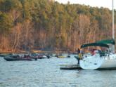 Anglers cruise past sailboats moored at Joe Wheeler State Park.