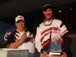 Andy Morgan of Dayton, Tenn., accepts his victory trophy from James Key of EverStart Batteries.