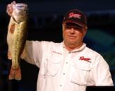 Miles Johnson of Beaver Creek, Ohio, stands with his 5-pound, 14-ounce Lake Hamilton lunker.