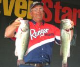 Edward Gettys of Stevenson, Ala., demonstrates local pride with his final day's catch, which weighed 20 pounds, 6 ounces.