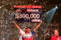 2004 FLW Tour champion Luke Clausen smiles as he hoists his hefty check in a sea of celebratory confetti.