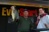 Pro Daryl Deka of Wellington, Fla., holds up the kicker bass of his 21-pound, 12-ounce winning string.