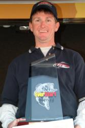 Pro Allan Glasgow proudly displays his first-place trophy after winning the EverStart event on Santee Cooper.