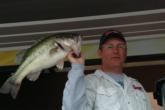 Dick Shaffer holds up a fat Tenn-Tom bass.
