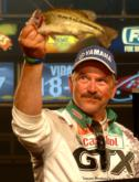 Darrel Robertson of Jay, Okla., caught five bass weighing 9 pounds, 6 ounces Saturday and finished second with a two-day total of 23-12. He earned $100,000.