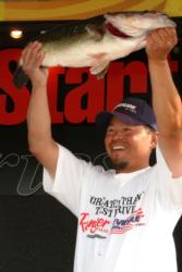 Pro Thanh Le of El Cajon, Calif., shows off his 9-pound, 8-ounce largemouth en route to a fourth-place finish at the California Delta event.