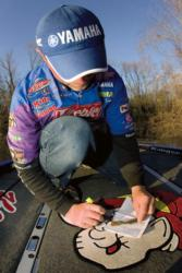 FLW Tour pro Dave Lefebre makes color adjustments to a bait while fishing high water.