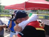 Craig Powers gets an emotional hug from his wife Kristi.