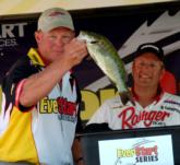 As Chris Cox looks on, pro Jeff Ritter of Prairie du Chien, Wis., finishes fourth with a final weight of 24 pounds, 12 ounces.