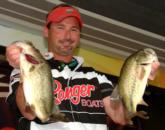 Derek Moyer of Alexandria, Va., caught five bass weighing 11 pounds 12 ounces to lead the Co-angler Division Friday.