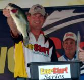 As Chris Poole looks on, Rick Morris weighs in a five-bass limit worth 13 pounds, 12 ounces Saturday. Morris finished second with a final weight of 25-0.