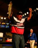 Pro Shannon Kehl pumps his fist as he weighs in his final fish, temporarily giving him the lead in the 2005 Wal-Mart FLW Walleye Tour Championship.