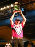 Robert Lampman holds up his trophy after winning the 2005 Wal-Mart FLW Walleye Tour Championship on the Mississippi River.