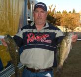 Mark Guin grabbed the day-one co-angler lead with a three-bass catch that weighed 7-13.