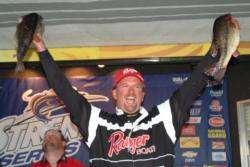 Jimmy Reese of Witter Springs, Calif., celebrates victory on Clear Lake by holding up part of his two-day 40-pound, 8-ounce catch.