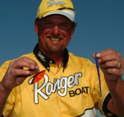 Jimmy Reese shows off some of his winning baits at the Delta: a crawdad-orange Rat-L-Trap and a Maragarita Mutilator Roboworm.