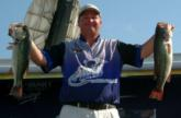 Runner-up Yancy Windham holds up the two best bass from his day-four sack of 19-14. He caught 38-2 over two days.