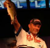 Boater Robert Walser holds up a 4-pound, 6-ouncer that helped put him in third place with a limit weighing 11-4.