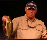 Co-angler leader Michael Wright weighs in a 2-pound, 3-ouncer from his day-one limit of 8 pounds, 15 ounces.
