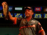 Robert Walser shows the crowd one of his tournament-winning bass. His three-day weight totaled 34 pounds, 10 ounces.