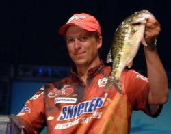 Brent Ehrler shows off a bass from his tournament-winning catch of 15 pounds, 1 ounce.