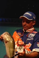 Clark Wendlandt is splashed by one of the bass that helped him take third place and $40,000.