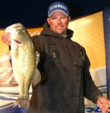 Pro Bobby Lane of Lakeland, Fla., shows off the 5-1/2 pound bass that put him in the cut on day two.