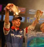 Aaron Hastings holds up his last two fish before winning the Wal-Mart FLW Tour event on Lake Travis.