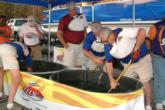 FLW Outdoors officials root around in the bump tubs, looking for Todd Auten