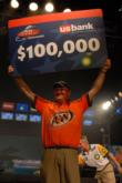Mark Davis holds up a check for $100,000 after winning his first FLW Tour event.