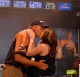 Andy Morgan gets victory kiss from his wife, Missy.
