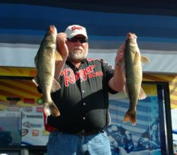Pro winner Pete Harsh holds up two Devils Lake walleyes that propelled him to his first FLW Walleye Tour victory.