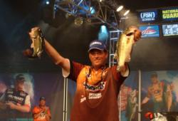Chris Baumgardner holds up a pair of 4-pound bass that propelled him to victory Sunday.