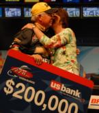Steve Clapper of Lima, Ohio, gets a kiss from his wife after winning $200,00 in the Chevy Open.