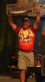 Local pro Scott Suggs triumphantly hoists his fish in the air en route to ending the day in second.