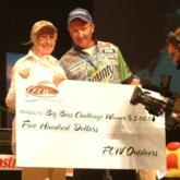 KATV Channel 7 Big Bass Challenge winner Ruth Woodruff poses with her $500 check and her pro partner Craig Powers.