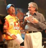 Scott Suggs gets a little faint when FLW Outdoors Chairman Irwin Jacobs hands him an actual check totaling $1 million.