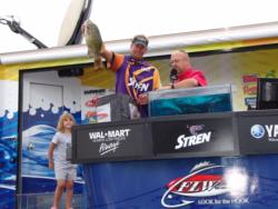 Fourth place finisher Mike Crisp was joined on stage by his 4-year-old daughter Tori.