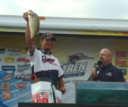 Pro winner Jason Christie holds up his biggest bass from day four on Lake of the Ozarks.