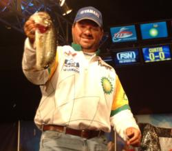 David Curtis holds up his biggest bass from day three on the Mobile Delta. The Trinity, Texas, native is second with 9 pounds, 8 ounces.