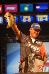 Mike Jackson shows off one of his tournament winning bass.