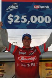Pro Justin Kerr of Simi Valley, Calif., holds up his first-place check after winning the Stren Series event on Lake Havasu.