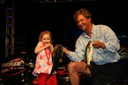 Moving into second place, Shayne Berlo had to hold his fish when his 5-year-old daughter Alana refused to help.