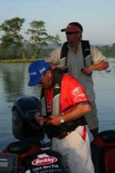 In the fourth-place boat, Ray Griffin, foreground, and his co-angler partner Robert Crosnoe strap on their PFD