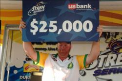 Ricky Fuqua of Effie, La., shows off his first place check after capturing first place in the Pro Division at the Stren Series event at the Red River.