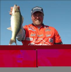Championship winner Tommy Skarlis holds up his kicker walleye from day four on the Missouri River.