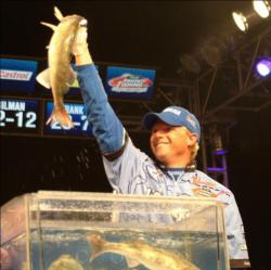 Second-place pro Robert Blosser holds up his kicker fish from day four of the Walleye Tour Championship.