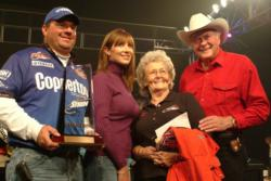 Stren Series Championship winner David Curtis poses with his wife and Forrest and Nina Wood.